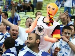 Eνόχλησε η φουσκωτή Μέρκελ στις κερκίδες των Ελλήνων φιλάθλων [photos]