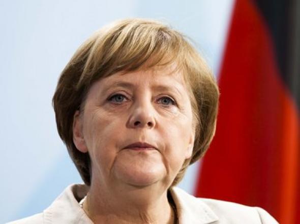 """Μέρκελ: """"Κάναμε πολλά για το ευρώ"""""""