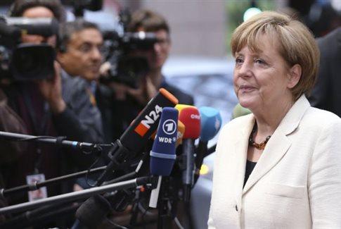 Στηρίζοντας Γιούνκερ για την Κομισιόν προσήλθε η Μέρκελ στις Βρυξέλλες
