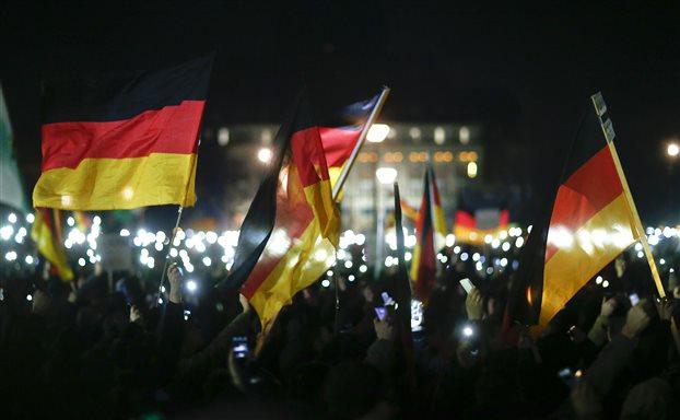 Μέρκελ: Καταδικάζει τις διαδηλώσεις κατά μεταναστών στη Δρέσδη