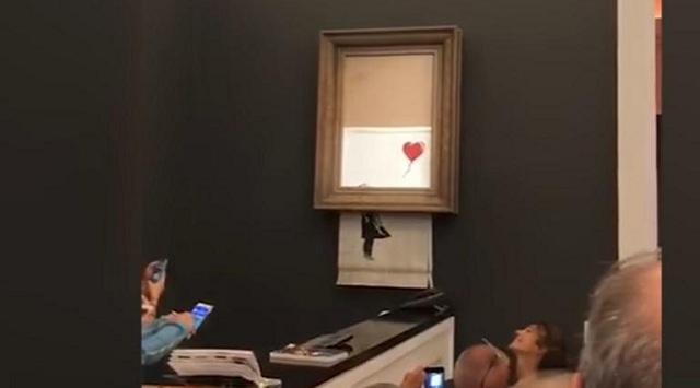 Δημοπρασία στον οίκο Sotheby΄s: Πασίγνωστο έργο του Banksy αυτοκαταστράφηκε, μόλις πουλήθηκε [Video]